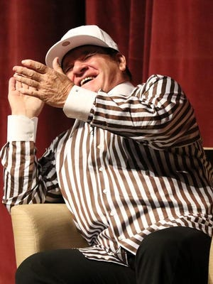 Former Cincinnati Reds player and manager Pete Rose breaks into a laugh during a lecture on ethics in sport on the campus of Miami University on Monday night.