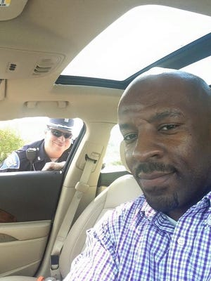 Greg Barnes Jr. posted this selfie with a police officer after he was pulled over this week, and the photo and accompanying message has gone viral on the Internet.