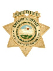 A file photo of the Carson City Sheriff's badge. Deputies are investigating a body found face down in a local pond Wednesday morning.