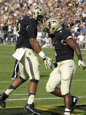 Purdue running back D.J. Knox (right) celebrates a touchdown with teammate Jonathon Curry.
