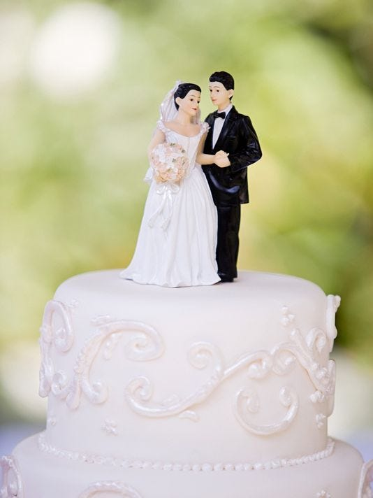 Bride and groom figurines top a wedding cake -- not from Sacramento wedding that didn't happen.