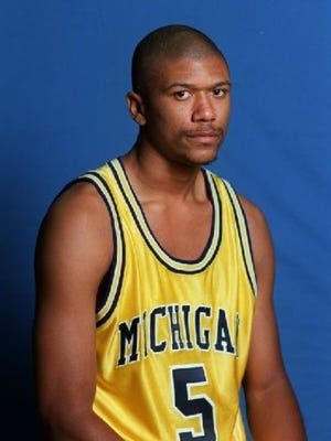 Jalen Rose while at the University of Michigan