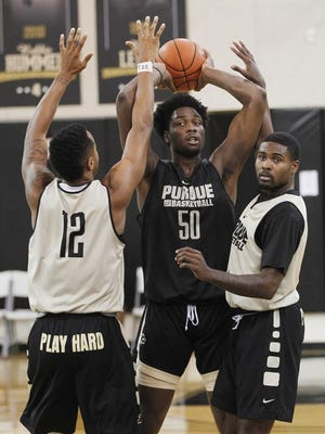 Purdue's Caleb Swanigan looks to pass during Boilermakers practice.