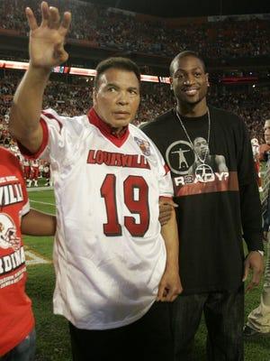 Muhammad Ali at a University of Louisville football game
