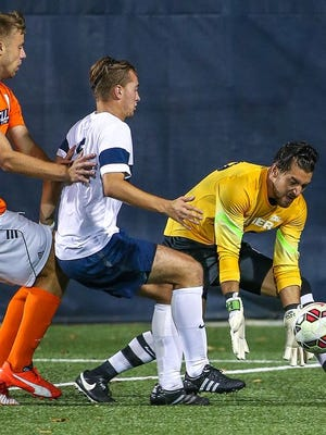 Goalkeeper Dallas Jaye (right), shown here in a previous Xavier match, had a career-high eight saves Wednesday and helped the Musketeers upset No. 1 Creighton in Omaha. XU won, 2-1.