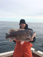 Shane Burke, Holmdel, with a  23-pound blackfish he caught this winter.
