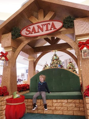 There's a brand new spot for Santa Claus. Four-year-old Kerrick Bauman checks out the throne.