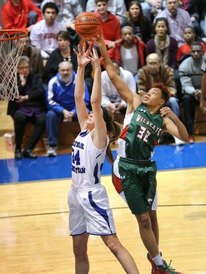 Lawrence North standout Ae'Rianna Harris vies for a rebound against Heritage Christian's Darby Foresman.