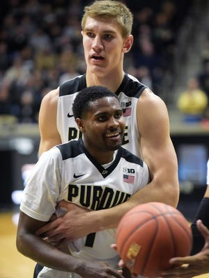Purdue's Johnny Hill (front) and Isaac Hass