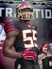 Linebacker Reggie Northrup smiles in an FSU black alternate jersey during an unveiling in 2013.