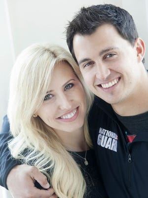 Graham Rahal and Courtney Force at Rick's Cafe Boatyard, March 5, 2014. They are racing's new power couple.