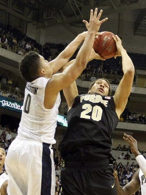 Purdue center A.J. Hammons (20) shoots against Pittsburgh guard James Robinson (0) during the first half at the Petersen Events Center.