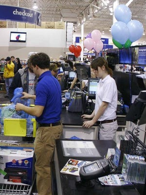 Shoppers at Best Buy wait for 5 am for the registers to open.