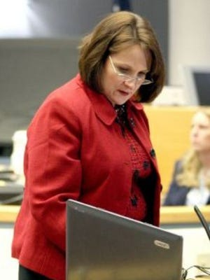 """n this 2009 file photo 12th Judicial District Attorney Diana Martwick sets up a video conference with Jahaira Santillon, ex-wife of Gerard Parvilus during a recess in a sentencing hearing before Judge James Waylon Counts on Wednesday, Jan. 27 at the Otero County Courthouse. Parvilus was sentenced to 34 1/2 years in prison for the Feb. 22, 2008, murder of Pierre """"Tony"""" Smith. From an undiclosed location, Santillon made a statement to Counts through the video conference."""