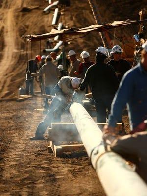 U.S. crews work on pipeline