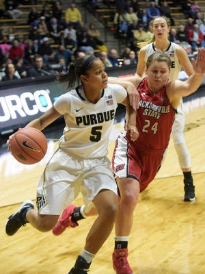 Purdue's Justine Hall looks to get around a defender on Nov. 16, 2015 at Mackey Arena in West Lafayette.
