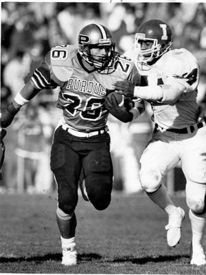 Purdue's Rod Woodson goes for yardage against Indiana's Leonard Bell during the 1986 Old Oaken Bucket Game.