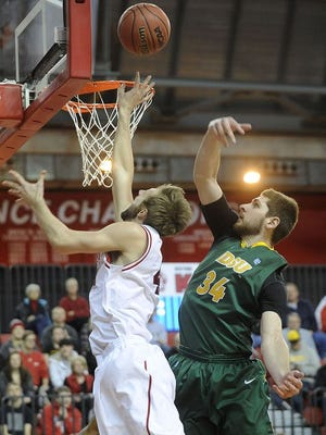 Senior Eric Robertson goes up for two against the Bison in a previous game between the two teams at the DakotaDome.