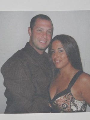 This photograph was hung outside the Mamaroneck apartment of Stephen Spina Sept. 18, 2007. Spina was found stabbed to death in his apartment.