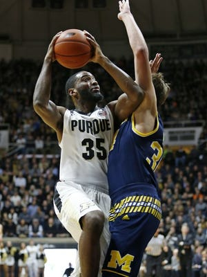 Purdue's Rapheal Davis goes up for a shot against Michigan.