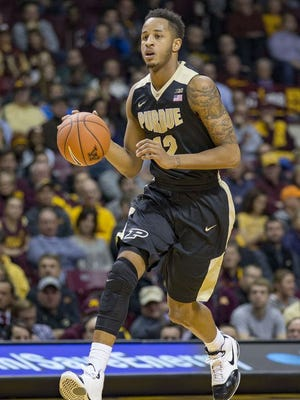 Purdue forward Vince Edwards (12) dribbles the ball in the first half against Minnesota at Williams Arena.