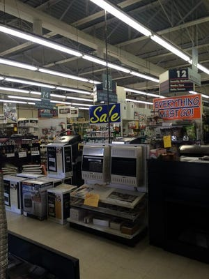 """Sale signs are prominent inside Town N' Country. """"Great buys,"""" retiring owner David Henry said."""