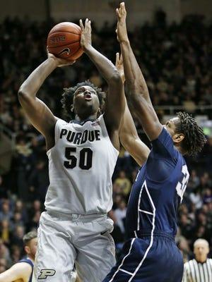 Purdue freshman power forward Caleb Swanigan goes up for a shot against Penn State.