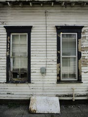 Many of Indianapolis' older homes, such as this one built in 1900, have problems with peeling lead-based paint.