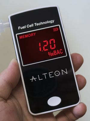 A hand-held breat- test device.