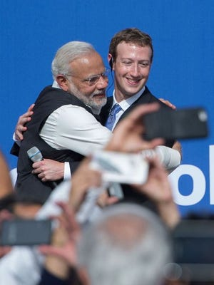 Indian Prime Minister Narendra Modi and Facebook CEO Mark Zuckerberg hug after a town hall meeting, at Facebook headquarters in Menlo Park, California, in September 2015.