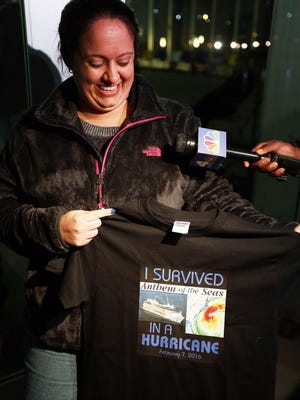 Michelle Verona from Hazlet, N.J., shows off the T-shirts she had made for her son Anthony Watterson and daughter Mia Watterson, who were aboard the Anthem of the Seas docking in Bayonne, N.J., Wednesday night.
