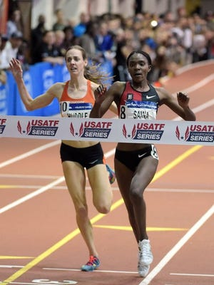 Former Iowa State runner Betsy Saina edges Molly Huddle to win the 5,000 meters Saturday at the Millrose Games in New York.