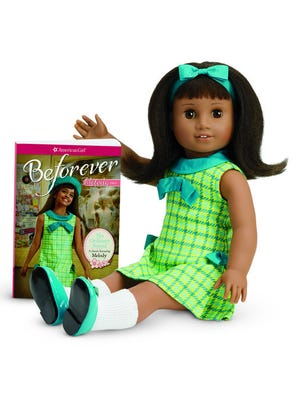 American Girl's BeForever Melody doll seen with book, 'No Ordinary Sound.'
