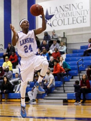 Former East Lansing standout Javon Haines, a sophomore guard at LCC, scores against Schoolcraft College Dec. 2. LCC won 90-80 in overtime on their home court.