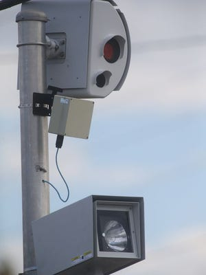 A traffic camera at the corner of Church Street and Broad records any vehicles that may run the red light, on Monday, October 20, 2014. These recordings are used later to issues tickets to the traffic violators.