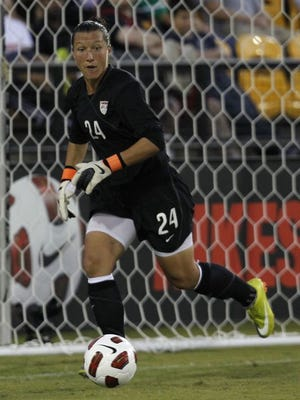 In a file photo from 2010, goalkeeper Jill Loyden of the U.S. women's team looks to run down an errant shot during the game against China at Kennesaw State University Soccer Stadium.