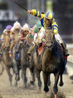Calvin Borel, aboard Super Savor, signals the win in the 2007 Kentucky Derby.