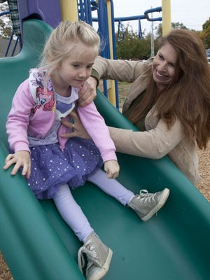 Katie Doyle, shown with her daughter Anna, has led the charge for a 20-minute recess in Middletown.