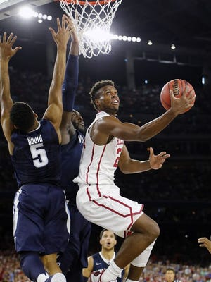 klahoma guard Buddy Hield (24) shoots against Villanova guard Phil Booth (5) during the first half of the NCAA Final Four tournament college basketball semifinal game Saturday, April 2, 2016, in Houston.