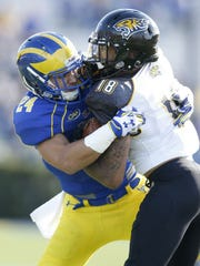 Safety Ryan Torzsa. tackling a Towson player in 2014, is part of a proven, experienced Hen defense.