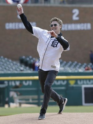 Josef Newgarden, IndyCar Series driver, looks good on his release point. Turns out he didn't get the ceremonial first pitch all the way to home plate.