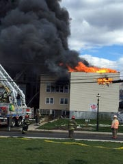 Fire engulfed three buildings along West Front Street in Keyport Friday.