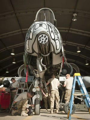Maintainers with the 455th Expeditionary Maintenance Squadron work on an A-10 Thunderbolt II during phase maintenance at Bagram Airfield, Afghanistan, August 8, 2012. A-10 tactical aircraft maintenance airmen are among those eligible for a new initial enlistment bonus of $2,000.