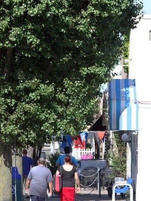 Pedestrians stroll Brighton Avenue in Long Branch's West End.