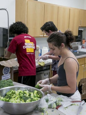 SUU students prepare lunches for children from low-income families for the Summer Lunch Program on June 21, 2015.