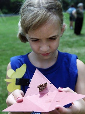 Children release butterflies at Camp Forget-Me-Not, a camp for grieving children.