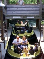 Sandi Rivers operates the Raging River Ride at Adventureland in Altoona on June 28, 1999.