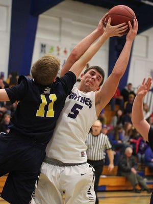Jake Allind pulls down a rebound for the Pittsville boys basketball team during this past season. Pittsville, along with Wisconsin Valley Lutheran and Northland Lutheran, could be joining the Central Wisconsin Conference in 2017-18.