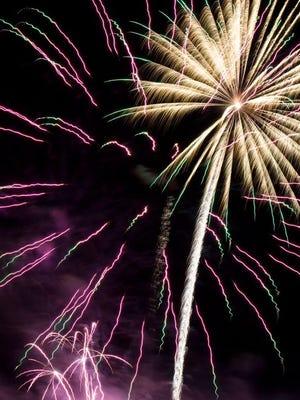 Fireworks explode in the night sky above Provident Park in Pomona, New York on July 3, 2015.