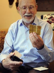 Jim Westlake looks at his drivers license from the 1950s along with other items found in his recently returned wallet. Scott Dodge found the wallet in 1959 in Ypsilanti, Michigan and returned it after nearly 55 years.